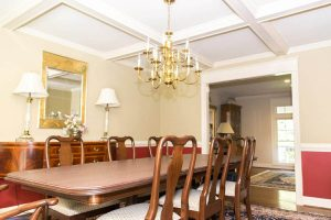 Interior shot of a dining room table and ceiling